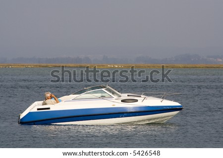luxury recreation boat in the ocean - stock photo
