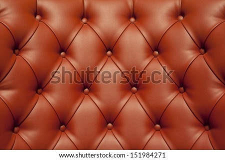 Luxury red leather  texture with button - stock photo