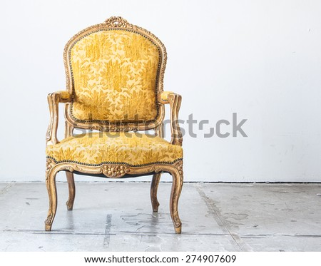 Luxury red vintage style armchair sofa in a vintage room - stock photo