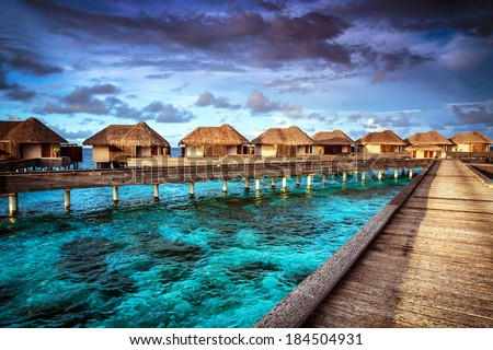 Luxury resort, many cute bungalow on the water, amazing view, beautiful coral under transparent water, summer holidays concept - stock photo