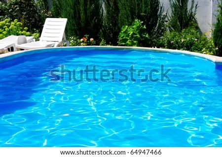 Luxury Resort Pool at the garden. - stock photo