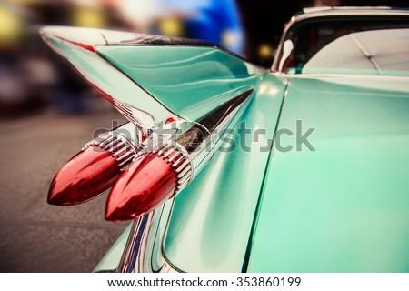 Luxury retro car driving in Las Vegas night city street - stock photo
