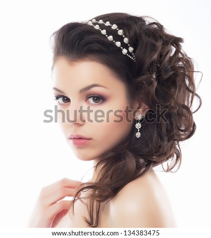 Luxury. Rich Stylish Brunette with Pearly Beads. Elegant Style - stock photo