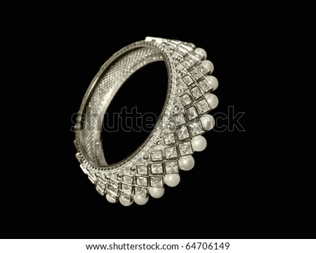 Luxury silver bracelet with pearls and crystals - stock photo