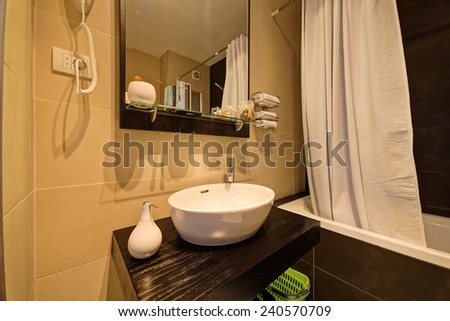 luxury small bathroom in hotel with stylish sink - stock photo