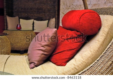 Luxury sofa with three pillows. - stock photo
