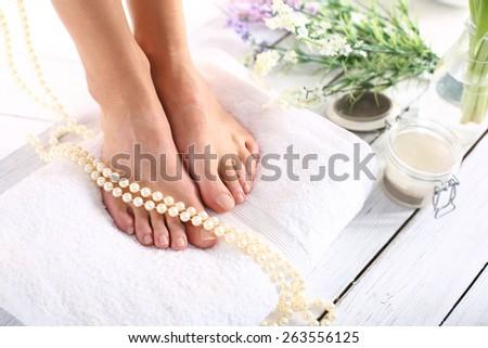 Luxury spa stupas.Beautiful feet of a woman during treatments. - stock photo