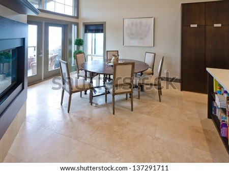 Luxury spacious  modern dining room with the table and the chairs and the fireplace. Interior design.