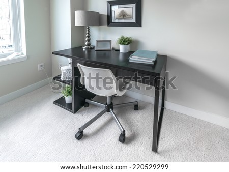 Luxury spacious modern nicely decorated den, home office with the table and the office chair. Interior design. - stock photo