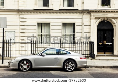 Luxury sport car in front of a house facade - stock photo