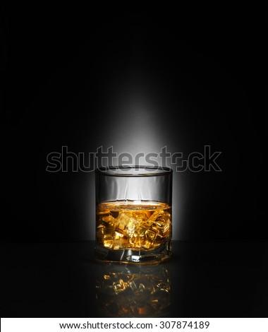 Luxury still life of whisky glass. point backgound light. Copyspace - stock photo