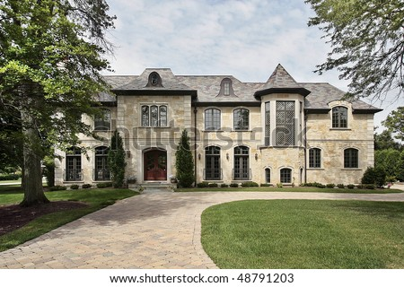 Luxury stone home in suburbs with turret