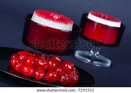 Luxury strawberry cheesecake with glassed cherries and scones on the side; food series; in IPTC status, instructions, you will find the recipe - stock photo