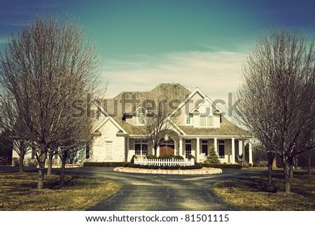 Luxury suburban house seen spring time - stock photo