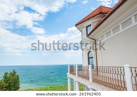 Luxury summer house on the hilly sea coast - stock photo