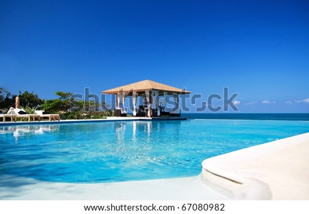 Luxury summerhouse with swimming pool, near Atlantic ocean - stock photo