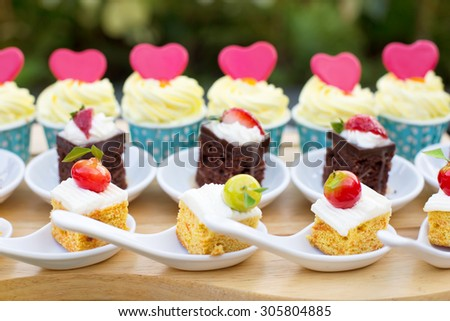Luxury Sweet Buffet Dessert for Holiday with pink Love Hearts on small Cakes Outdoor