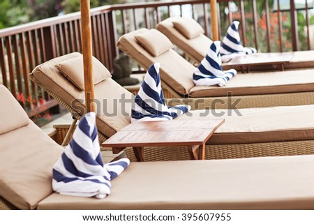 Luxury swimming pool and deck chair at the resort - stock photo