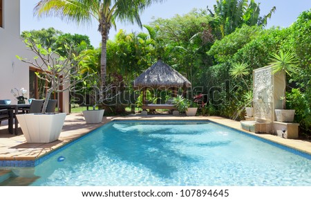 Luxury swimming pool and entertaining area in Australian mansion - stock photo