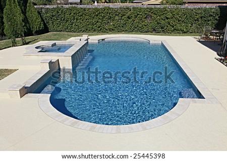 Luxury swimming pool in back yard - stock photo
