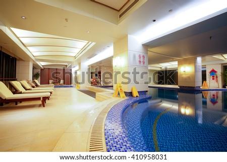 Luxury swimming pool interior. - stock photo