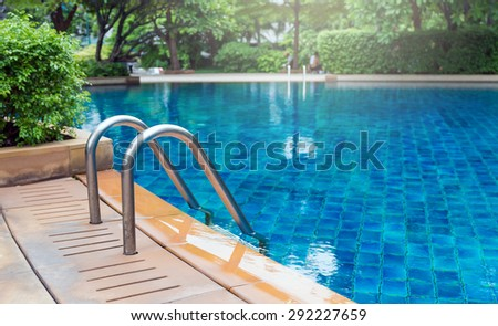 Luxury swimming pool with the garden - stock photo