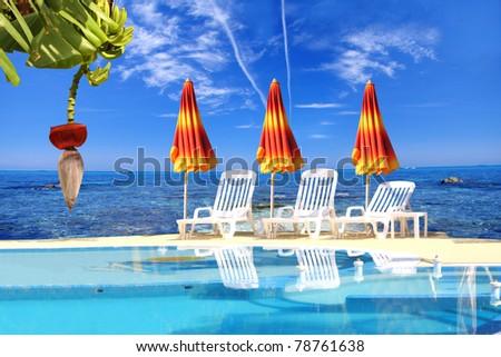 Luxury swimming pool with umbrellas - stock photo