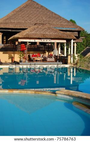 Luxury swimming pool with villa - stock photo