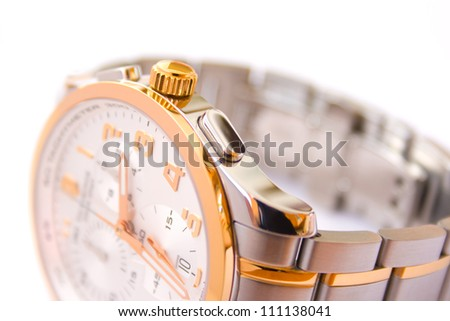 Luxury swiss wrist watch with chronograph - focus on control button - stock photo