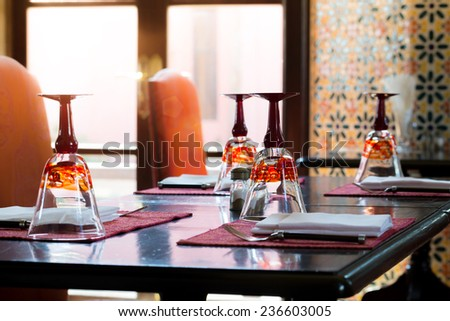 Luxury Table Settings In Restaurant with Flare Light - stock photo