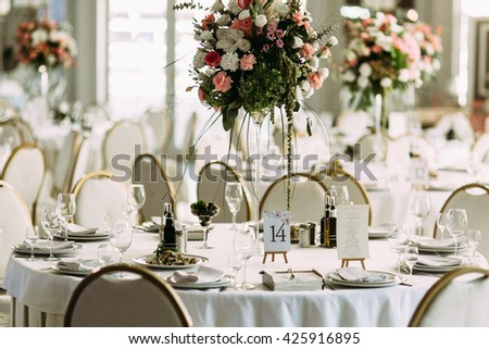 Luxury table with the bouquet of flowers - stock photo