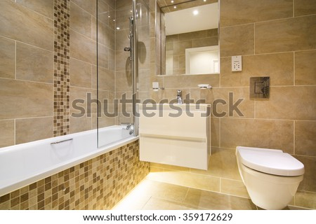 Luxury three piece bathroom in beige - brown with mosaic and natural stone tiles - stock photo