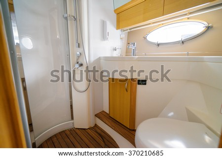 Luxury traveling. Bathroom interior of modern motor yacht.