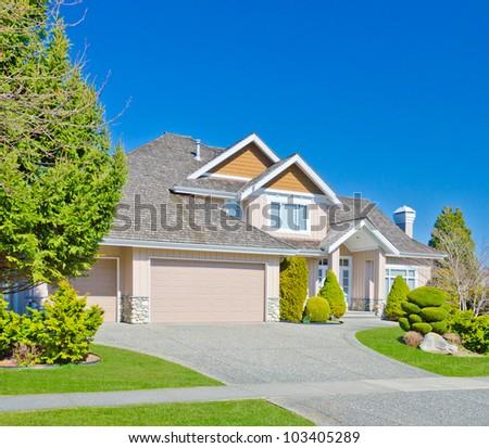 Luxury triple garage doors home. - stock photo