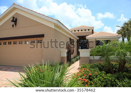 Luxury tropical model home - stock photo