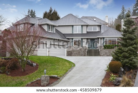Luxury two level house with garage and driveway. Also nice landscape design around. Northwest, USA - stock photo
