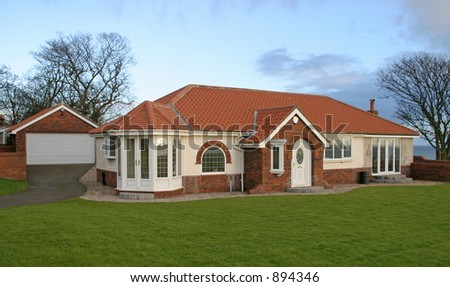 Luxury UK bungalow with garage - stock photo