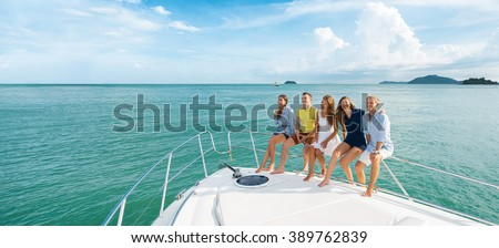 Luxury vacation. Group of young beautiful people smiling on the yacht. Banner.  - stock photo
