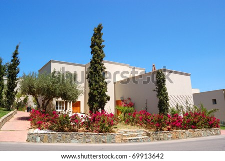 Luxury villa decorated with flowers, Crete, Greece - stock photo