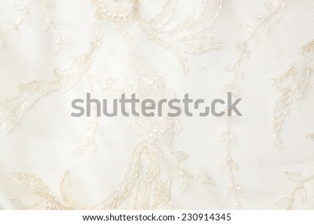 Luxury vintage ivory silk cloth for bridal dress with embroidery floral pattern and Czech beads - stock photo