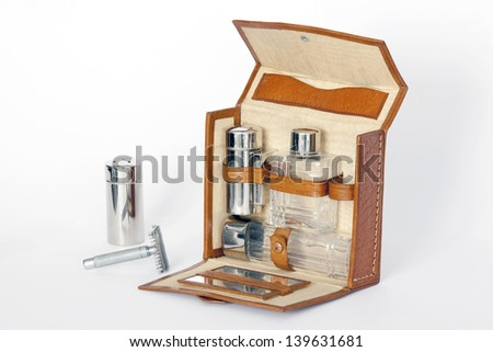 Luxury vintage shaving kit isolated on White with two accessories out. Old shaving kit.