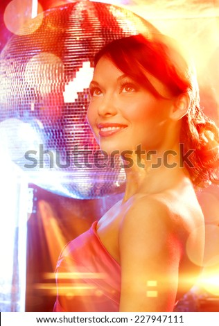 luxury, vip, nightlife, party, clubbing concept - beautiful woman in evening dress with disco ball - stock photo