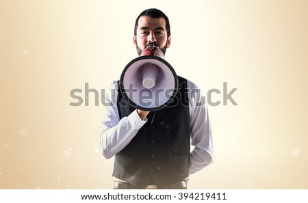 Luxury waiter shouting by megaphone
