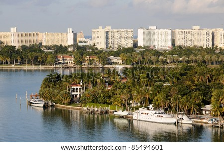 Luxury waterfront homes in tropical Miami, Florida - stock photo