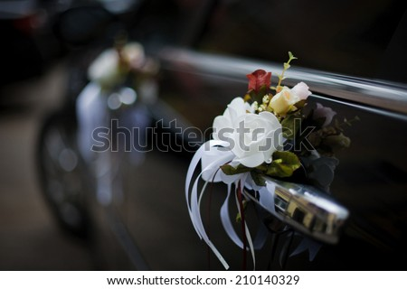Luxury wedding car decorated with flowers - stock photo