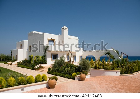 Luxury white house located over a sea - stock photo