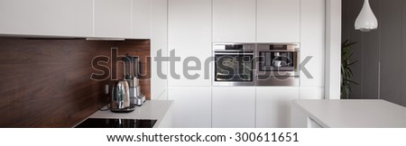 Luxury white kitchen in exclusive apartment, panorama