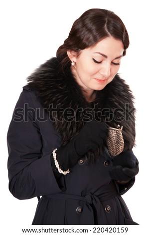 Luxury woman in a black coat looks into an empty wallet - stock photo
