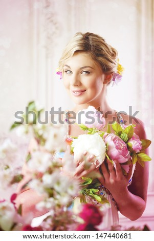 Luxury woman in fashionable dress in expensive interior - stock photo