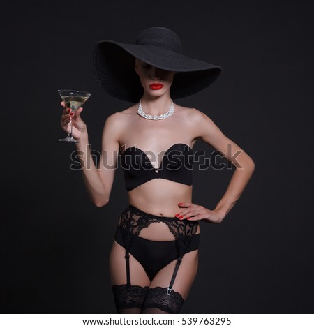 Luxury woman with Martini glasses in sexy underwear.